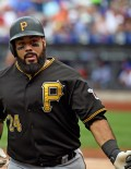 Pittsburgh Pirates first baseman, PEDRO ALVAREZ, is congratulated as he heads for the dugout after hitting a home run in the second inning against New York Mets starter, MATT HARVEY, at CitiField, giving the Pirates a 1-0 lead. The Pirates went on to win 8-1, sweeping the Mets three consecutive games.