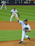 New York Yankees closer, Mariano Rivera, throws the last pitch of his career against Tampa Bay Rays pinch hitter Yunel Escobar in the top of the ninth inning at