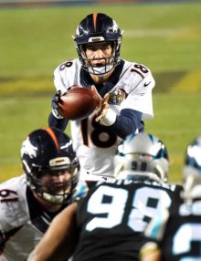 Denver Bronco's quarterback PAYTON MANNING receives the snap from center in the closing minutes of SUPER BOWL 50 at Levi's Stadium. MANNING led his team to a 24-10 victory becoming the oldest quarterback to win a Super Bowl and the only quarterback to win a SUPER Bowl with two teams.
