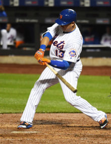 New York Mets shortstop, ASDRUBAL CABRER, doubles in the 5th and 6th runs of the inning off of starting San Francisco Giants pitcher Jake Peavy. The Mets went on to win 13-1.