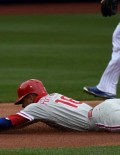 Philadelphia Phillies second baseman, CESAR HERNANDEZ, is tagged out by New York Mets shortstop ASDRUBAL CABRERA while attempting to steal second base in the first inning of the Mets home opener due to an excellent throw by Mets catcher Travis d' Arnaud. The Mets went on to win 7-2.