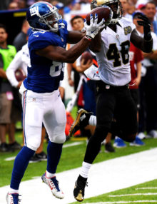 PLAY OF THE GAME- New York Giants wide receiver VICTOR CRUZ hauls in a 34 yard pass from Eli Manning to set up Josh Browns winning 23 yard filed  goal as time expired. CRUZ wrestled the ball away from New Orleans Saints defensiive back KEN CRAWLEY.