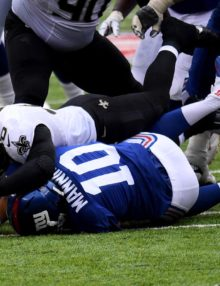 New York Giants ELI MANNING fumbles the ball when sacked by New Orleans MICHAEL MAUTI