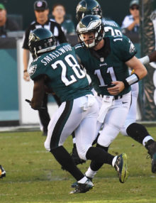 Philadelphia Eagles rookie quarterback,CARSON WENTZ, hands off  to rookie running back WENDELL SMALLWOOD for a first down against the Pittsburgh Steelers in the first quarter at Lincoln Financial Field.  SMALLWOOD ran for 79 yards and one touchdown, leading the Eagles to a 34-3 victory.