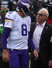 Eagles owner JEFF LURIE talks with former Eagle now Vikings QB SAM BRADFORD