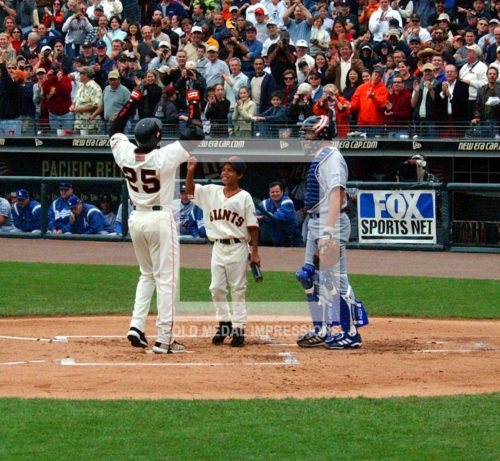 Barry Bonds Hi Fives bat boy after hitting his 73rd home run on October 7, 2001.(AP Photo/Dick Druckman)