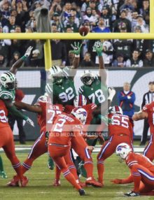 Buffalo Bills kicker DAN CARPENTER kicks the first of three field goals 47 yards in the second quarter against the New York Jets at MetLife Stadium. The Bills went on to win 22-17.