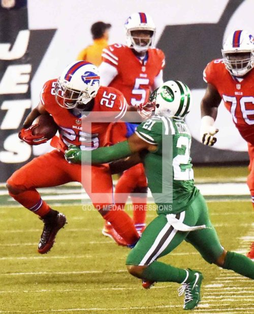 Buffalo Bills running back LE SEAN MCCOY runs through the arms of New York Jets free safety MARCUS GILCHRIST for a first down in the first quarter at MetLife Stadium. LE SEAN MCCOY ran for 112yards leading the Bills to a 22-17 victory over the New York Jets.