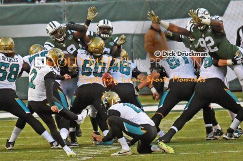 Jacksonville Jaguars kicker JASON MYERS kicks a 49 yard field goal