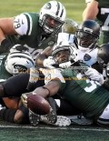 Jets running back CHRIS IVORY stretches for a touchdown