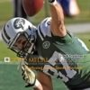 New York Jets wide receiver ERIC DECKER slams ball to the ground after scoring a touchdown