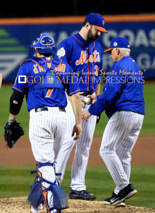 Mets TERRY COLLINS takes the ball from MATT HARVEY