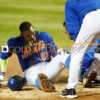 New York Mets outfielder YOENIS CESPEDES hits a foul tip off of his left knee
