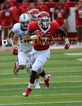 Rutgers University running back, ROBERT MARTIN, runs for a first down against Kansas University in the first quarter at High Point Solutions Park, Piscataway, N.J. Rutgers went on to win 27-14.