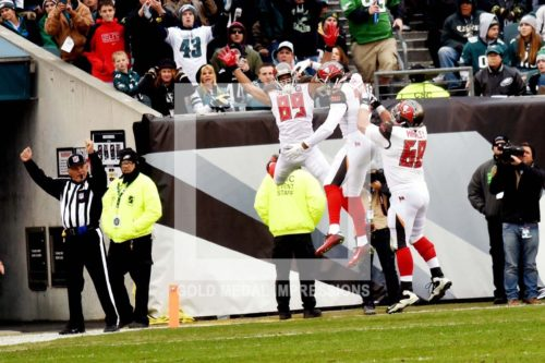 Tampa Bay Buccaneers MIKE EVANS, RUSSELL SHEPARD, and JOE HAWLEY celebrate a touchdown scored by MIKE EVANS in the first quarter against the Philadelphia Eagles tying the game 7-7. The Buccaneers went on to win 45-17.