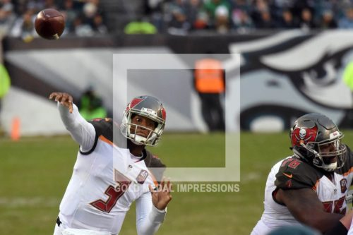 Tampa Bay Buccaneers rookie quarterback JAMEIS WINSTON throws his fifth touchdown pass against the Philadelphia Eagles in the third quarter to his tight end Cameron Brate. WINSTON completed 19 of 29 passes for 246 yards, tying Matthew Stafford's rookie mark, and leading the Buccaneers to a 45-17 victory.