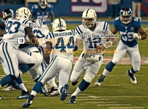 Indianapolis Colts quaterback, ANDREW LUCK, hands off to AHMAD BRADSHAW in the first quarter against the New York Giants. Bradshaw, who formerly played for the New York Giants, rushed for 50 yards and gained 29 yards on pass receptions leading the Colts to a 40-24 victory.