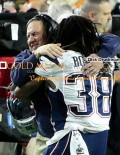 New England Patriots head coach, BILL BELICHICK, gets a victory hug from running back BRANDON BOLDON after defeating the Seattle Seahawks 28-24 in Super Bowl XLIX.