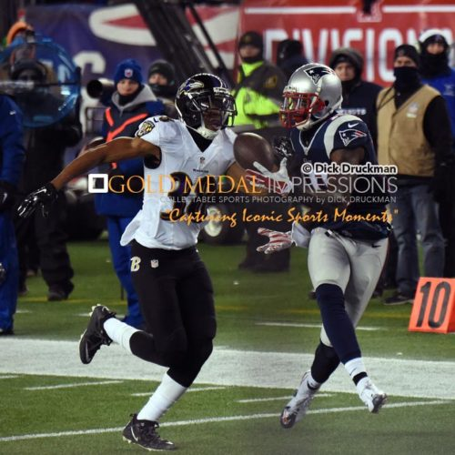 New England Patriots wide receiver, BRANDON LAFELL, scores winning touchdown in the fourth quarter against the Baltimore Ravens, as Ravens' cornerback, MELVIN RAASHAN attempts to defend. The Patriots defeated the Ravens 35-31.
