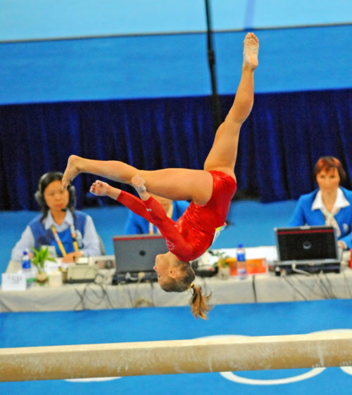 USA gymnast Shawn Johnson does a somersault on the balance beam at the Beijing Olympics in the Women's individual all-around competition.(AP Photo/Dick Druckman)