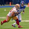San Francisco 49ers linebacker, CHRIS BORLAND, intercepts pass in front of New York Giants wide receiver PRESTON PARKER in the second quarter at MetLife Stadium. BORLAND. the defensive star of the game, made 8 tackles, 4assists, and 2 interceptions, leading the 49ers to a 16-10 victory.