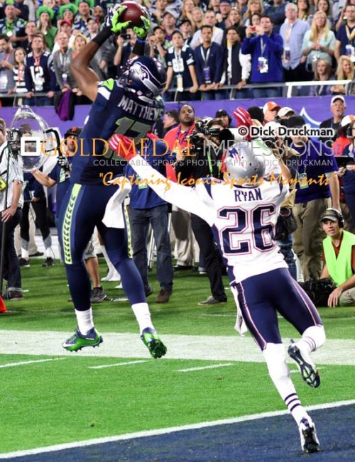 Seattle Seahawks receiver, CHRIS MATTHEWS, makes a leaping catch in the end zone for a touchdown against New England Patriots cornerback LOGAN RYAN in the second quarter of Super Bowl XLIX. The Patriots went on to win 28-24.