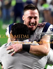 New England Patriots wide receiver, DANNY AMENDOLA, who scored one of the teams touchdowns hugs coach after winning Super Bowl XLIX. The Patriots defeated the Seahawks 28-24.