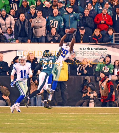 Dallas Cowboys wide recever, DEZ BRYANT, catches his first of three touchdown passes against Philadelphia Eagles cornerback, BRADLEY FLETCHER, in the first quarter at Lincoln Financiial Field. The Cowboys went on to defeat the Eagles 38-27 taking over the sole possession of first place in the NFC East.