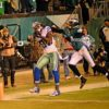 DEZ BRYANT catches his second of three touchdown passes against Philadelphia Eagles cornerback BRADLEY FLETCHER. The Eagles went on to win 38-27.