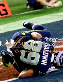 Seattle Seahawks wide receiver DOUG BALDWIN scores a touchdown against the New England Patriots in the third quarter of Super Bowl XLVI. The Patriots went on to win 28-24.