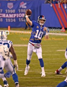 New York Giants quarterback, ELI MANNING, throws a pass in the first quarter against the Indianapolis Colts. MANNING completed 27 of 52 passes for 359 yards and 2 touchdowns. Despite his efforts, the Giants lost 40-24.