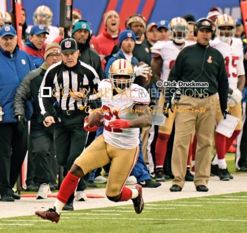San Francisco 49ers running back, FRANK GORE, runs for a first down in the second quarter against the New York Giants. GORE ran for 95 yards on 19 carries leading the 49ers to a 16-10 victory.