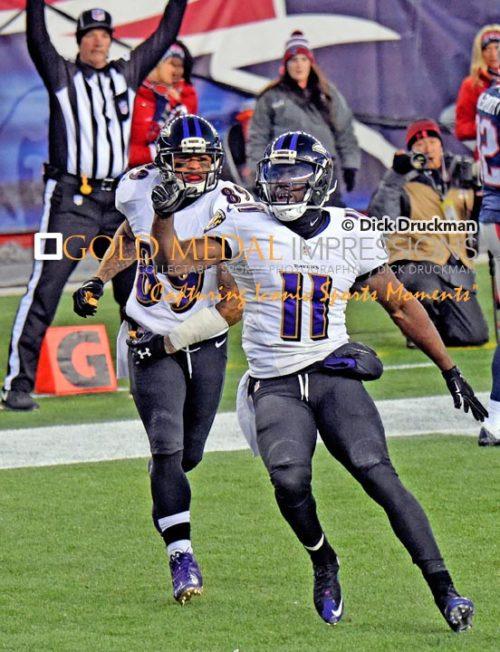 Baltimore Ravens wide receiver, KAMAR AIKEN, scores in the first quarter of the NFC divisional playoff game against the New England Patriots giving the Ravens a 7-0 lead. The Patriots went on to win 35-31.