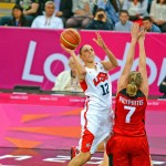 USA Diana Taiurasi drives for a score against Canada in the first quarter as defender Pilypaitis attempts to block the shot. Taurasi was high scorer with 15 points and led her team to a 91-48 victory in the quarter final game,(AP PHOTO/DICK DRUCKMAN)