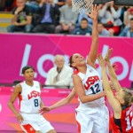 USA basketball star Diana Taurasi scores against Canada in the first quarter as defender L. Murphy attempts to block the shot. Taurasi scored 15 points leading the USA team to a 91-48 victory.(AP Photo/Dick Druckman)