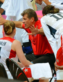 USA olympic women's basketball team head coach, Geno Auriema, makes a point in the team huddle in the fourth quarter quarter final game against Canada. The USA team went on to defeat Canada 91-48.(AP Photo/Dick Druckman)