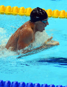 USA swimmer Ryan Lochte leads competition in the breast stroke leg of the 400 Individual Medley Finals in the first swimming event of the London Olympics. Lochte went on to win the gold medal.(AP Photo/Dick Druckman)