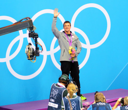 USA swimmer Ryan Lochte waves to the crowd after receiving the gold medal for the 400 Meter Individual Medley in the London Olympics.(AP Photo/Dick Druckman)