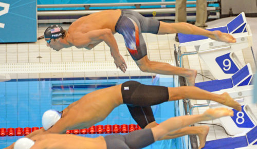 Michael Phelps gets off to a poor start in the Butterfly leg of the men's 400meter individual medley in the London Olympics. Phelps finished fourth as Ryan Lochte easily won the Gold Medal.(AP Photo/Dick Druckman)