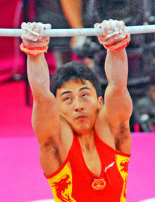 China gymnist, Zhe Feng, eyes the horizontal bar in the team competition on the London Olympics. China went on to wn the gold medal.
