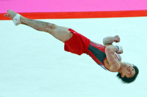 China gymnist, Kohei Uchimura, does a summersault in the floor exercise competition in the team competition. China went on to win the gold medal.