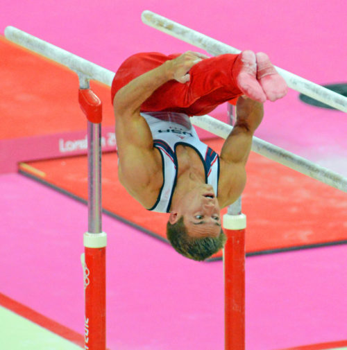USA gymnist, Samuel Mikulak , dismounts from the parallel bars in the team competition of the London Olympics. The US finished fifth while China, Japan, and Great Britain took the gold, Silver, and Bronze, respectively.(