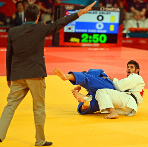 Asley Gonzalez(white) from Cuba expresses shock after being thrown by Song Dae-Nam(Blue)from Korea. Song won the gold medal in the men's judo finals.(AP Photo/Dick Druckman)