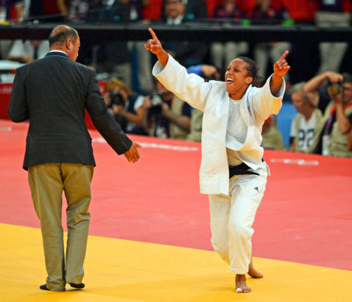 gold! Lucie Decosse (white) from France throws Thiele Kerstin (Blue) from Germany in the women's final judo competition in the London Olympics. Lucie Decosse won the gold medal.