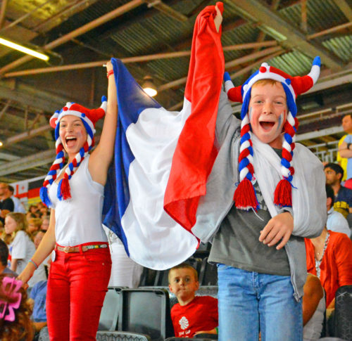 Avid fans, Lora and David Burgun, from Strasburg France, celebrate Lucie Decosse's gold medal victory in the women's Judo Finals in the London Olympics.(AP Photo/Dick Druckman)