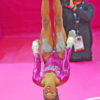 USA gymnist Gabrielle Douglas eyes the world upside down as she competes on the uneven bars at the London Olympics. Gabby won the gold.