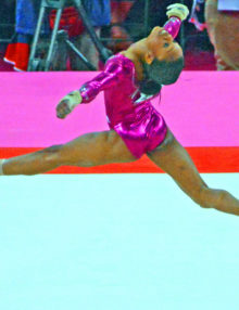 Gabby Douglas performs gracefully in the floor exercise of the women's individual all-around competion in the London Olympics. Douglas wins the gold medal.