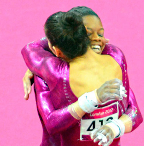 USA gymnist, Aly Reisman hugs her teammate Gabrielle(Gabby) Reisman during the women's individual all-around competition. Gabby went on to win the gold medal while Aly just missed winning a bronze medal.(AP Photo/Dick Druckman)