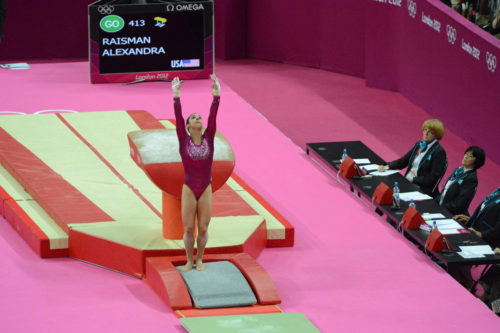 USA gymnist Aly Raisman on the vault exercise during the 2012 Summer Olympics in London England. Aly Reisman flips in her floor exercise.