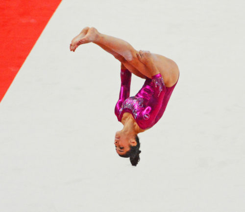USA gymnast Aly Raisman showcasing her skills on the floor exercise during the 2012 Summer Olympics in London England.